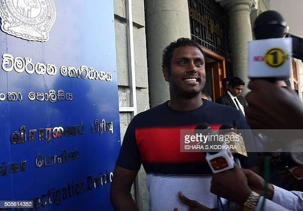 Sri Lanka cricket skipper Angelo Mathews is surrounded by media as he leaves the police Financial Crimes Investigation Division building in Colombo...