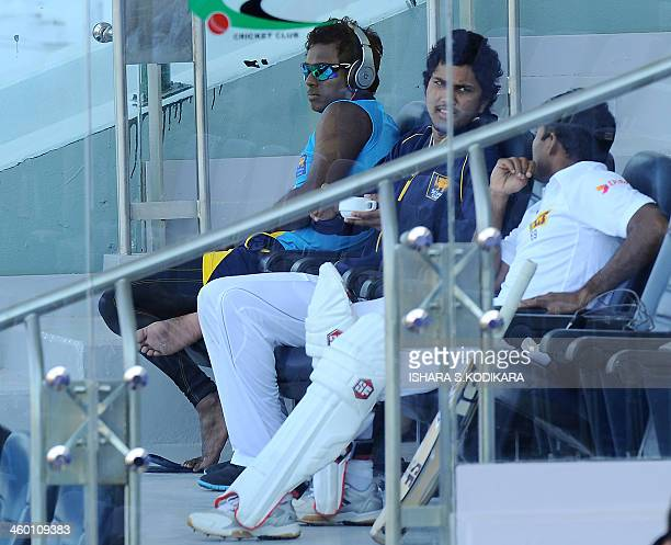Sri Lanka cricket team captain Angelo Mathew Dinesh Chandimal and Mahela Jayawardene look on during the third day of the first cricket Test match...