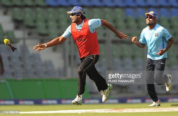 Sri Lanka cricket team captain Kumar Sangakkara plays with a dart ball with teammates during a training session at The Wankhede cricket stadium in...