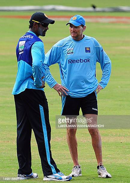Sri Lanka cricket team coach Graham Ford speaks with Thisara Perera during a practice session at the R Premadasa Cricket Stadium in Colombo on July...