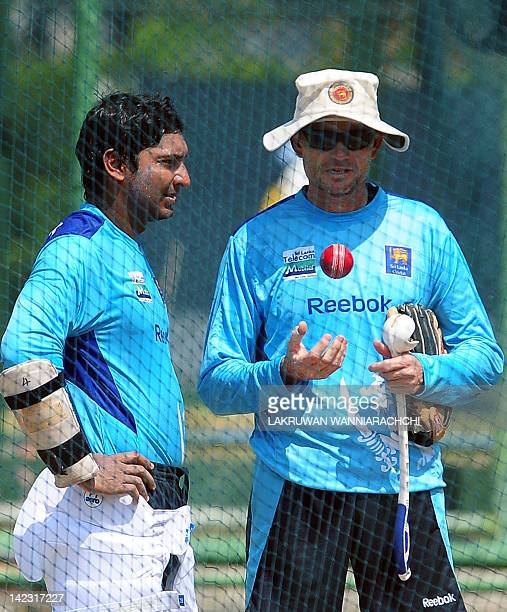 Sri Lanka cricketer Kumar Sangakkara chats with coach Graham Ford during a training session ahead of the second Test match against England in Colombo...