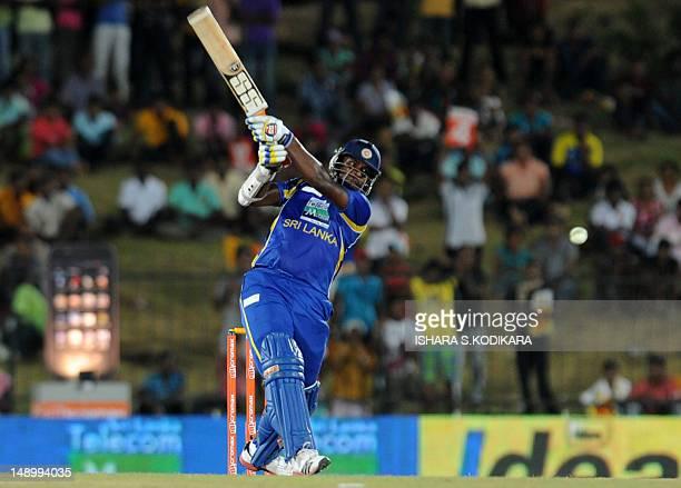 Sri Lanka cricketer Thisara Perera plays a shot during the opening oneday international match between Sri Lanka and India at the Suriyawewa Mahinda...