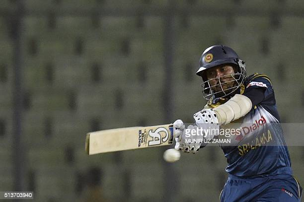 Sri Lanka cricketer Tillakaratne Dilshan plays a shot during the Asia Cup T20 cricket tournament match between Pakistan and Sri Lanka at the...