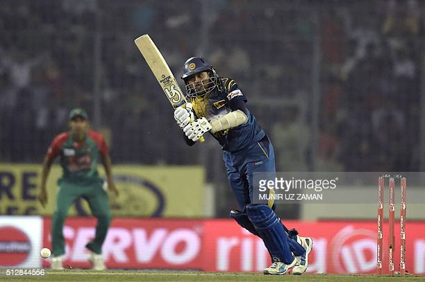 Sri Lanka cricketer Tillakaratne Dilshan plays a shot during the match between Bangladesh and Sri Lanka at the Asia Cup T20 cricket tournament at the...