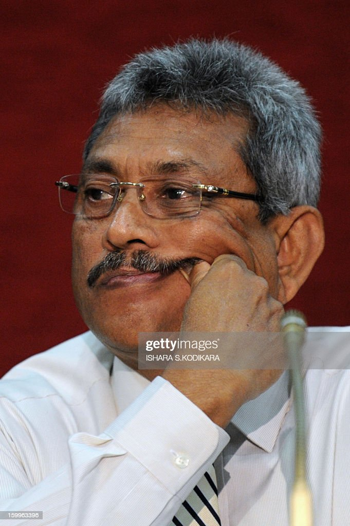 Sri Lanka Defence Secretary Gotabhaya Rajapakse speaks with reporters in Colombo on January 24, 2013. Rajapakse said senior officers nominated by him for advanced US military training programs had been rejected. He planned to take up the issue with a high-level US delegation visiting Colombo at the weekend. AFP PHOTO/ Ishara S. KODIKARA