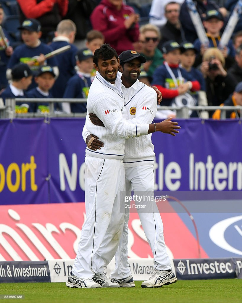 Sri Lanka fielder <a gi-track='captionPersonalityLinkClicked' href=/galleries/search?phrase=Suranga+Lakmal&family=editorial&specificpeople=5742345 ng-click='$event.stopPropagation()'>Suranga Lakmal</a> (l) is congratulated after catching out England batsman Nick Compton during day one of the 2nd Investec Test match between England and Sri Lanka at Emirates Durham ICG on May 27, 2016 in Chester-le-Street, United Kingdom.