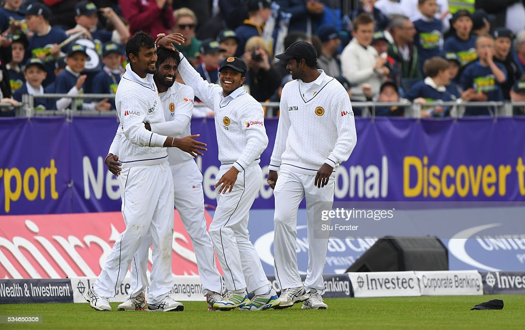 Sri Lanka fielder <a gi-track='captionPersonalityLinkClicked' href=/galleries/search?phrase=Suranga+Lakmal&family=editorial&specificpeople=5742345 ng-click='$event.stopPropagation()'>Suranga Lakmal</a> (l) is congratulated by team mates after catching out England batsman Nick Compton during day one of the 2nd Investec Test match between England and Sri Lanka at Emirates Durham ICG on May 27, 2016 in Chester-le-Street, United Kingdom.