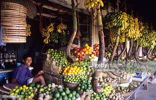 Sri Lanka, Galle, teenage boy selling fruit at market
