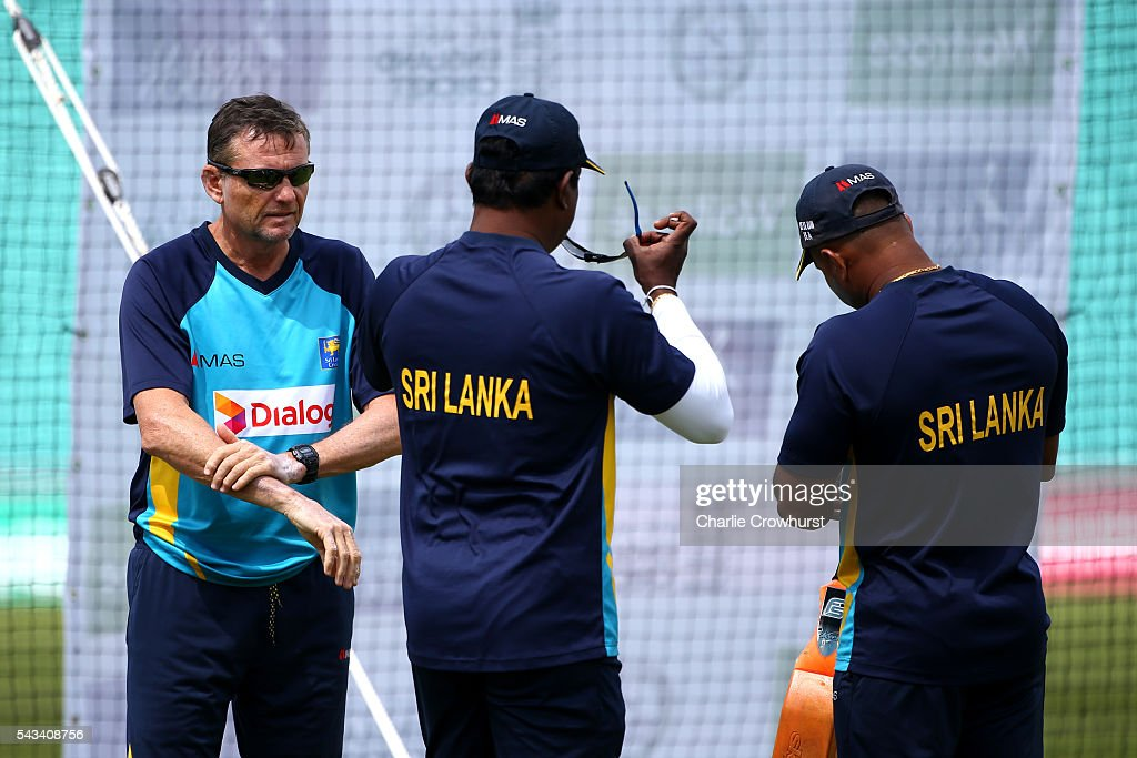 Sri Lanka head coach Graham Ford puts on sun cream during an England & Sri Lanka Nets Session at The Kia Oval on June 28, 2016 in London, England.