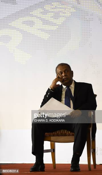 Sri Lanka Media Minister Mangala Samaraweera looks on during the opening of a regional seminar on the safety of journalists in Colombo on December 4...