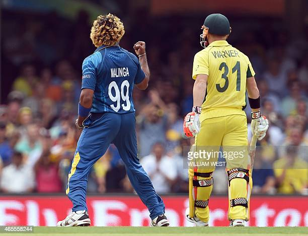 Sri Lanka paceman Lasith Malinga gives Australian batsman David Warner a sendoff after dismissing him during their 2015 Cricket World Cup Group A...