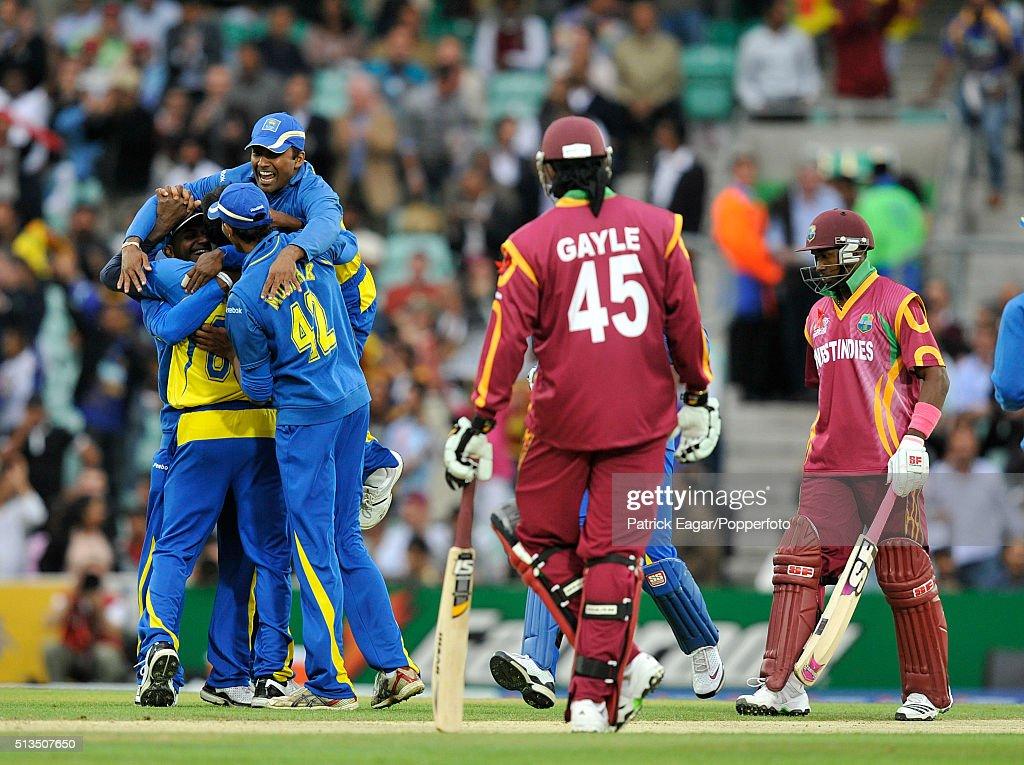 Sri Lanka players celebrate as Chris Gayle of West indies looks on after Angelo Mathews of Sri Lanka dismisses West Indies batsman Dwayne Bravo...