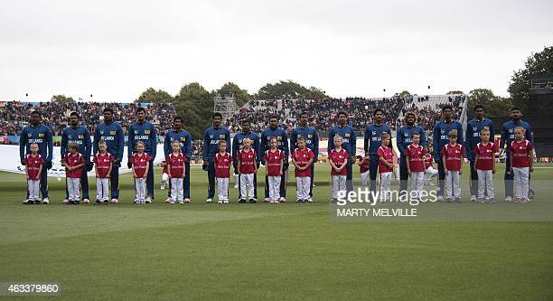 Sri Lanka players line up for their national anthem during the opening Cricket World Cup one day cricket match between New Zealand and Sri Lanka at...