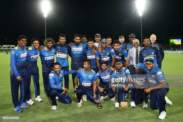 Sri Lanka pose with the winners trophy after the T20 warm up match between the Australian PM's XI and Sri Lanka at Manuka Oval on February 15 2017 in...