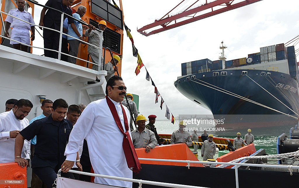 Sri Lanka President Mahinda Rajapakse (R) arrives to launch the Chinese-built Colombo International Container Terminal (CICT) in Colombo on August 5, 2013. Sri Lanka launched its biggest port with Chinese funding to turn Colombo into a strategic shipping hub along the world's most lucrative trading route. AFP PHOTO/ Ishara S. KODIKARA