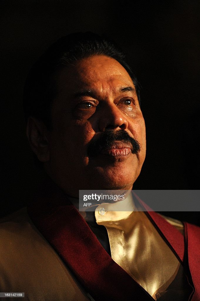 Sri Lanka President Mahinda Rajapakse looks on during the launch of a website for the state-run film studious in the southern district of Hambantota on March 5, 2013. The president has pledged to turn the arid region, his home constituency, into a new commercial and arts capital of the country emerging from nearly four decades of ethnic bloodshed. AFP PHOTO / Ishara S. KODIKARA