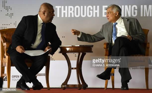 Sri Lanka Prime Minister Ranil Wickremesinghe and Media Minister Mangala Samaraweera speak during the opening of a regional seminar on the safety of...