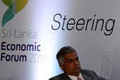 Sri Lanka Prime Minister Ranil Wickremesinghe attends an economic forum in Colombo on January 7 2016 Sri Lankas new government is trying to woo...