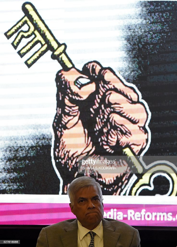Sri Lanka Prime Minister Ranil Wickremesinghe looks on during an event to mark International Press Freedom in Colombo May 3, 2016. Sri Lankas new government has unveiled a Right to Information Act that is scheduled to be discussed and approved by parliament shortly. / AFP / ISHARA