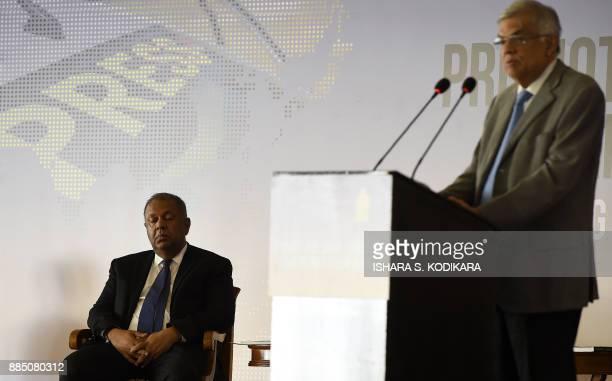 Sri Lanka Prime Minister Ranil Wickremesinghe makes a speech as Media Minister Mangala Samaraweera looks on during the opening of a regional seminar...