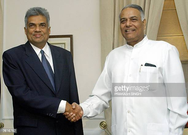 Sri Lanka Prime Minister Ranil Wickremesinghe shakes hands with India Foreign Minister Yashwant Sinha prior to a meeting in New Delhi 19 October 2003...