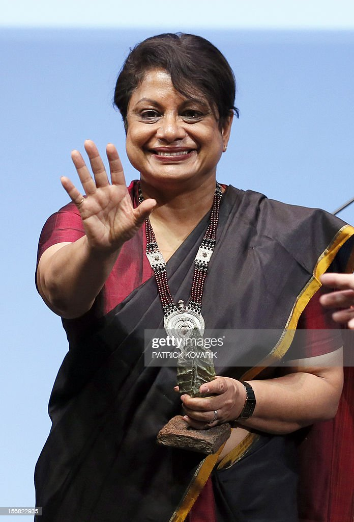 Sri Lanka Radhika Coomaraswamy celebrates after receiving the jury's special prize, during the ceremony of release of the Jacques Chirac Foundation's 2012 Award for the prevention of conflicts, on November 22, 2012 at the Quai Branly Museum in Paris.