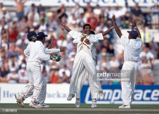 Sri Lanka spin bowler Muttiah Muralitharan is congratulated after taking a wicket during the Cornhill Test match against England at the Kennington...