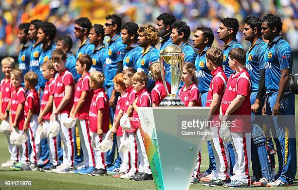 Sri Lanka stand for the national anthem during the 2015 ICC Cricket World Cup match between Sri Lanka and Bangladesh at Melbourne Cricket Ground on...