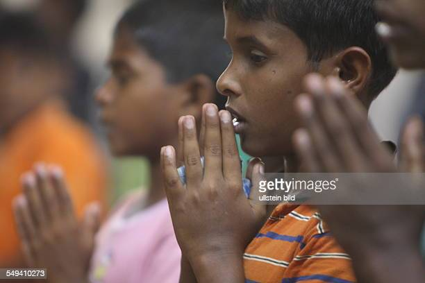 LKA Sri Lanka Uswetaketyawa The Salesian fight against pedophilia and helps the young boys to get education A praying boy