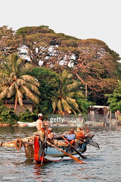 Sri Lanka Western fishermen on boat in Negombo Lagoon Fishing has been the center of culture in Negombo for centuries