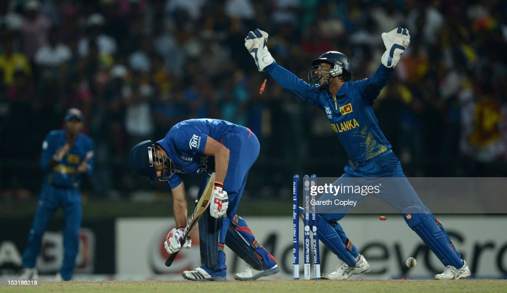 Sri Lanka wicketkeeper <a gi-track='captionPersonalityLinkClicked' href=/galleries/search?phrase=Kumar+Sangakkara&family=editorial&specificpeople=206804 ng-click='$event.stopPropagation()'>Kumar Sangakkara</a> celebrates after <a gi-track='captionPersonalityLinkClicked' href=/galleries/search?phrase=Ravi+Bopara&family=editorial&specificpeople=4106027 ng-click='$event.stopPropagation()'>Ravi Bopara</a> of England is bowled by Jeevan Mendis during the ICC World Twenty20 2012 Super Eights Group 1 match between Sri Lanka and England at Pallekele Cricket Stadium on October 1, 2012 in Kandy, Sri Lanka.