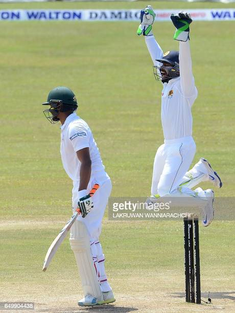 Sri Lanka wicketkeeper Niroshan Dickwella leaps into the air as he celebrates after taking a catch to dismiss Bangladesh batsman Shakib Al Hasan...