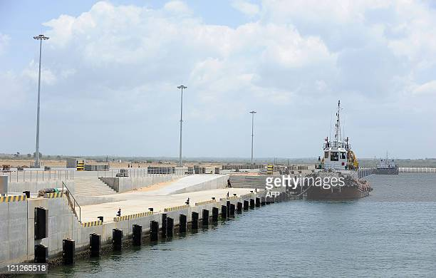 Sri Lankaeconomyportaviationsports by Amal Jayasinghe A barge is berthed at the new port in Hambantota on August 2 2011 When the Asian tsunami hit...