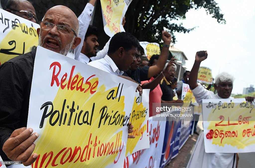 Sri Lankan activists demanding the release of Tamil detainees held in custody for long periods without trial demonstrate outside the main prison in Colombo on October 16, 2015. The prisoners were arrested during Sri Lanka's 37-year civil war for suspected involvement with Tamil rebels fighting for a separate homeland for the ethnic minority, but remain in custody even after the end of the war in May 2009.