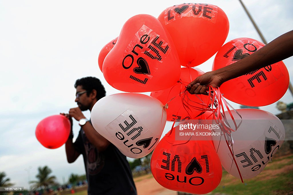 Sri Lankan activists hold up balloons during a celebration of Valentine's Day in Colombo on February 14, 2013. Valentine's Day in mainly Buddhist Sri Lanka is often noted as a marketing opportunity for hotels and gift shops capitalising on the holiday. AFP PHOTO/Ishara S.KODIKARA
