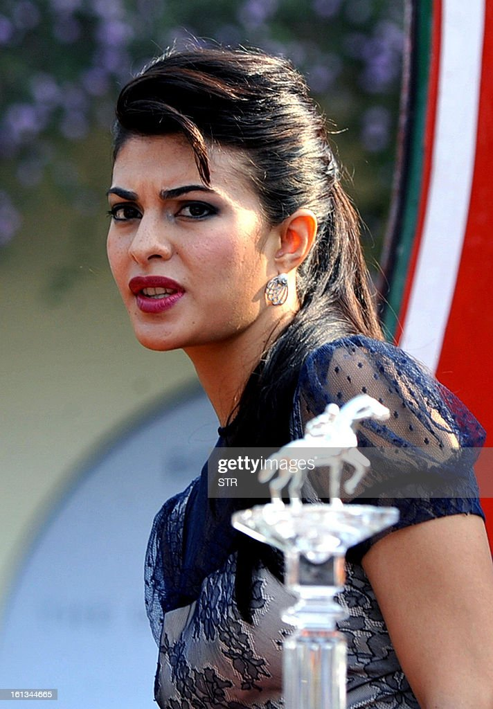 Sri Lankan actress and model and Bollywood film actress Jacqueline Fernandez poses during the 'Hello! Classic Derby Race 2013' in Mumbai on February 10, 2013. AFP PHOTO