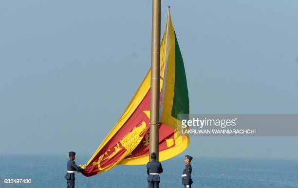 Sri Lankan Air Force personnel hoist the national flag in an Independence Day parade rehearsal in Colombo on February 2 2017 Sri Lanka is preparing...