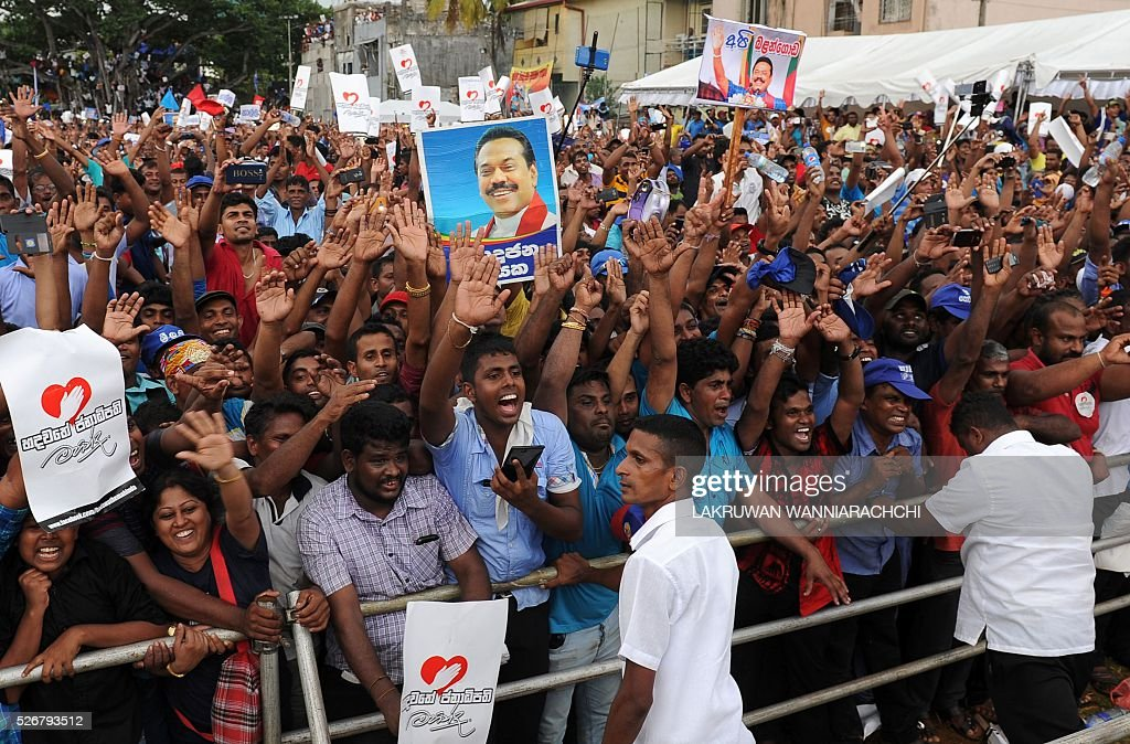 Sri Lankan anti-government activists take part in a May Day rally in Colombo on May 1, 2016. Former President Mahinda Rajapakse who leads a faction of his successor Maithripala Sirisenas Freedom Alliance staged a rival rally to demonstrate his popularity despite being defeated twice in January and August of last year. / AFP / LAKRUWAN