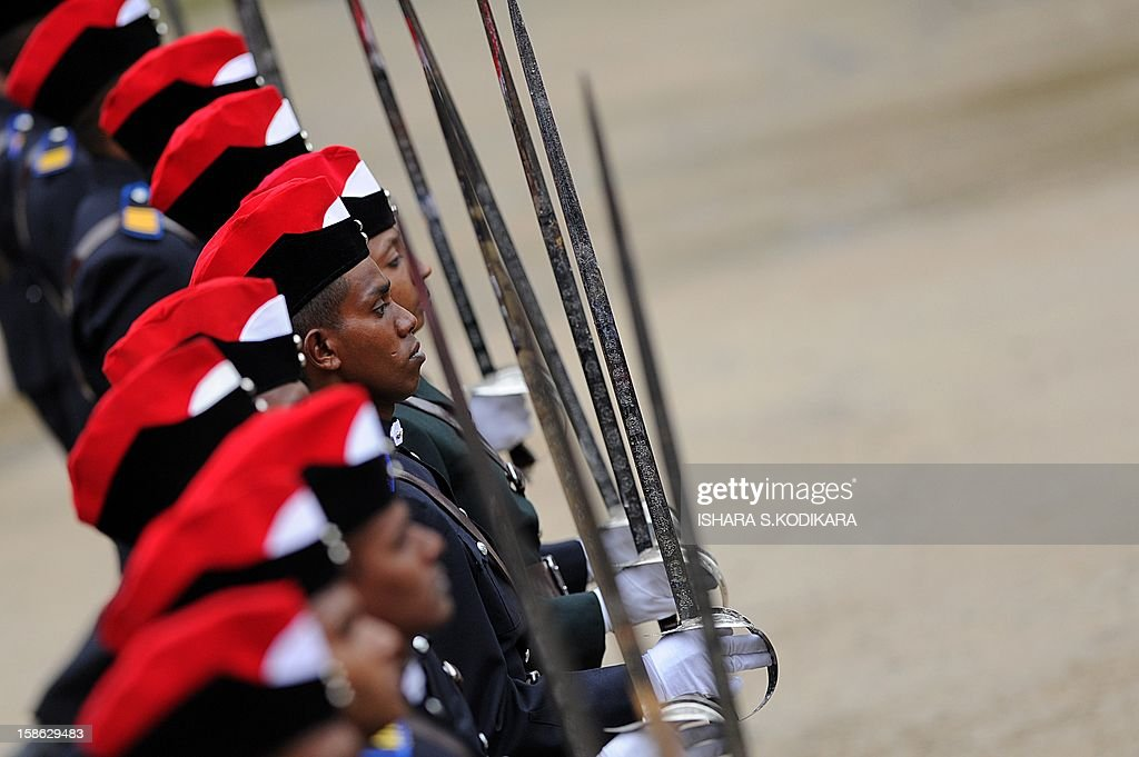 Sri Lankan army cadets stand in formation during a graduation ceremony for some 157 Sri Lankan army officers, where Indian Army Chief General Bikram Singh attended as chief guest, in the island nation's central district town of Diyatalawa on December 22, 2012. General Singh is on a five-day official visit to Sri Lanka. AFP POHOTO/Ishara S