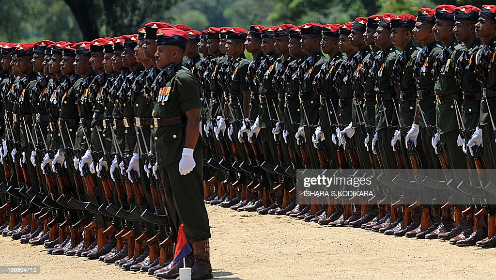 Sri Lankan Army commandos stand at attention during a ceremony commemorating fallen soldiers in the eastern region of Thoppigala on April 18, 2013. The monument commemorated government troops killed while wresting control over the region from Tamil Tiger rebels during the war. AFP PHOTO/ Ishara S. KODIKARA