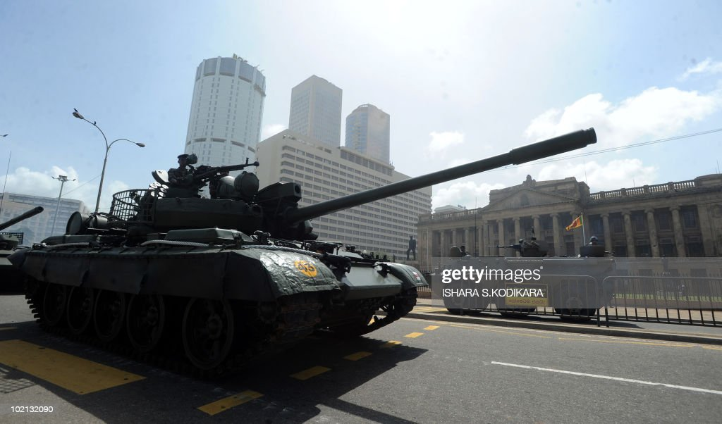 Sri Lankan army tanks roll along the sea-front promenade during a rehearsal in Colombo on June 16, 2010. Security forces are preparing for June 18 celebrations of Sri Lanka's military victory over Tamil Tiger rebels last May, which ended the 37-year ethnic conflict. AFP PHOTO/Ishara S. KODIKARA