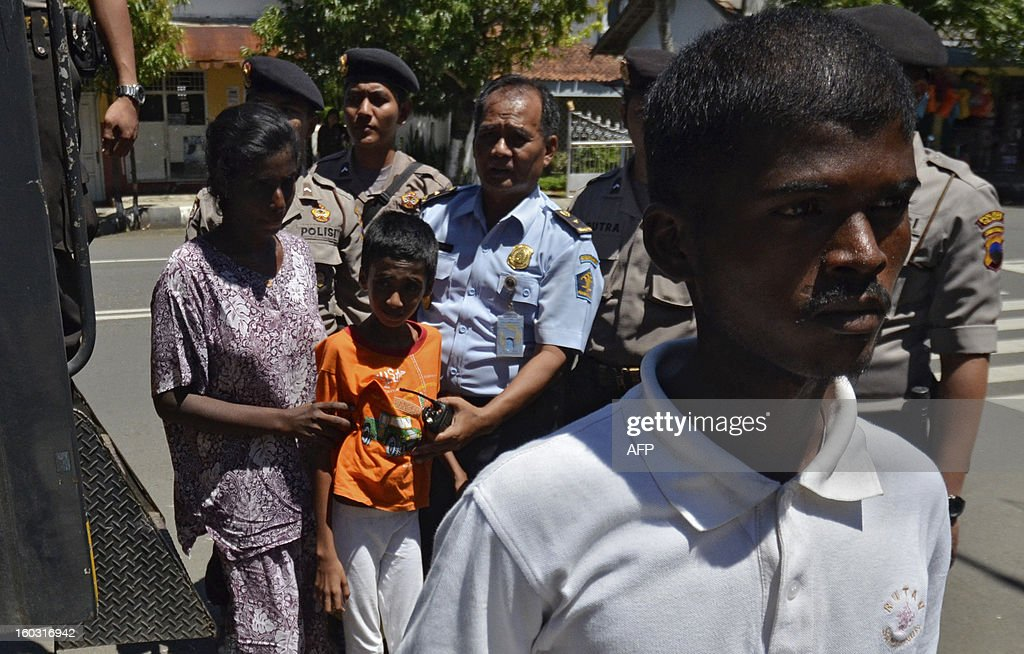 Sri Lankan asylum seekers arrive in Cilacap on January 29, 2013, after their boat was stranded in the waters off the central Java provincial district of Cilacap. A boat carrying Sri Lankan migrants believed to be headed for Australia hit high waves off Indonesia's Java island, killing two and left one missing, police said.