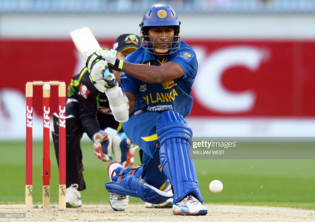 Sri Lankan batsman Ajantha Mendis (R) hits a reverse sweep as Australian wicketkeeper Matthew Wade (L) looks on during their Twenty20 match played at the Melbourne Cricket Ground (MCG), in Melbourne on January 28, 2013. AFP PHOTO/William WEST USE