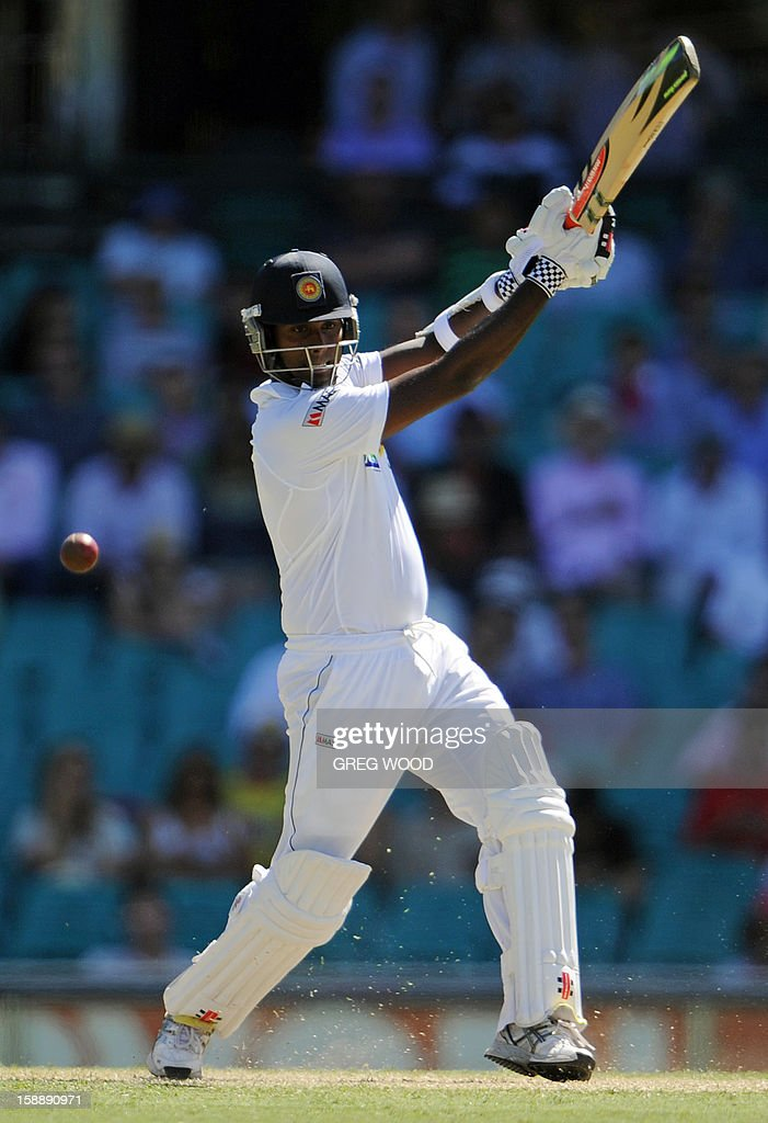 Sri Lankan batsman Angelo Mathews plays a cut shot on day one of the third cricket Test between Sri Lanka and Australia at the Sydney Cricket Ground on January 3, 2013. IMAGE STRICTLY RESTRICTED TO EDITORIAL USE - STRICTLY NO COMMERCIAL USE AFP PHOTO / Greg WOOD