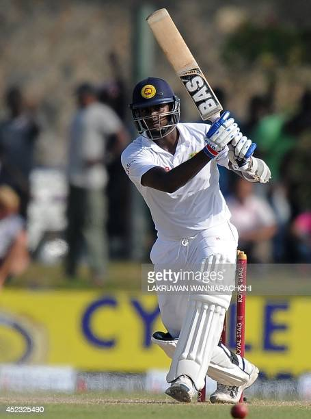Sri Lankan batsman Angelo Mathews plays a shot during the third day of the opening Test match between Sri Lanka and South Africa at the Galle...