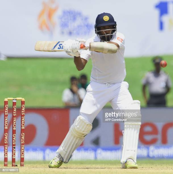 Sri Lankan batsman Dilruwan Perera plays a shot during the third day of the first Test match between Sri Lanka and India at Galle International...