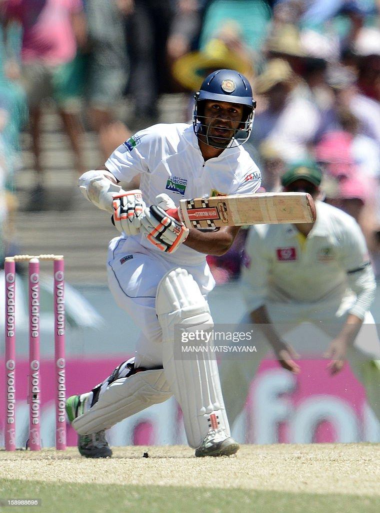Sri Lankan batsman Dimuth Karunaratne plays a shot on day three of the Third cricket Test match between Australia and Sri Lanka at the Sydney Cricket Ground on January 5, 2013.