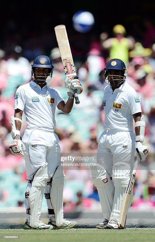 Sri Lankan batsman Dimuth Karunaratne (L) reacts after scoring his half-century (50 runs) as captain Mahela Jayawardena (R) looks on, on day three of the third cricket Test match between Australia and Sri Lanka at the Sydney Cricket Ground on January 5, 2013.