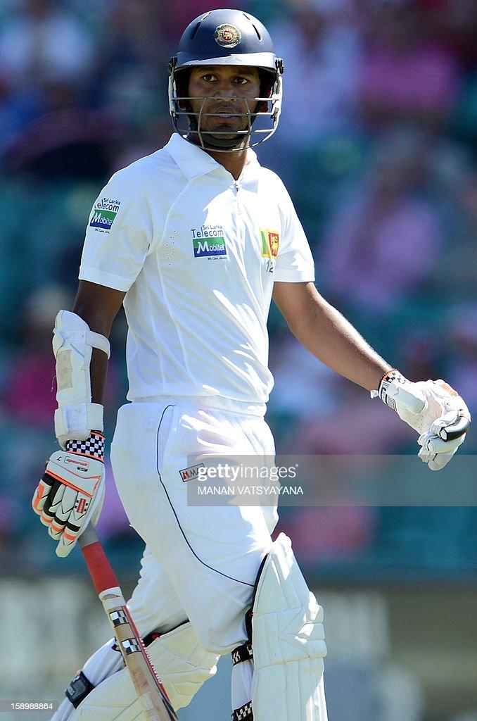 Sri Lankan batsman Dimuth Karunaratne walks back to pavilion after his dismissal on day three of the third cricket Test match between Australia and Sri Lanka at the Sydney Cricket Ground on January 5, 2013.