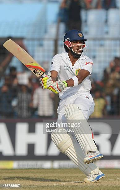 Sri Lankan batsman Dinesh Chandimal plays a shot during the first day of the second Test match between Bangladesh and Sri Lanka at The Zahur Ahmed...